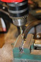 réalisation fixation cable frein à main